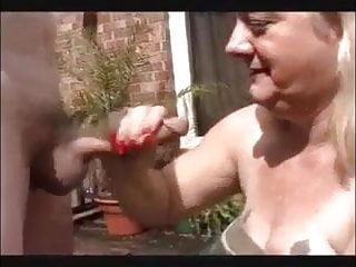 Granny sucks cock in back yard...