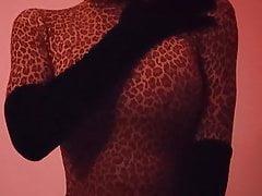 Leopard-print zentai girl enjoying her vibrator
