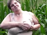 Old fat BBW mother fucks herself outdoor