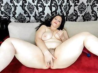 Woman vith tremendous tits masterbates