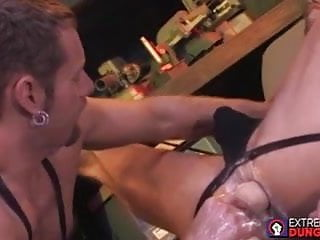 Gay fisting with a gaping anus spread with a lubed bare hand