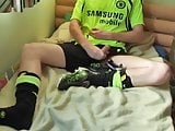 Guy cumming on Adidas trainers in football kit