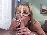 Mature smokes cigarette while sucking cock