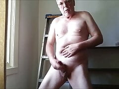 Masturbating my hard cock in front of the window