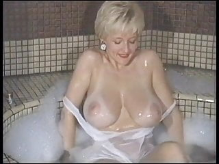 Playing with her massive tits bath...