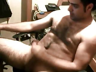 Hairy dude wanking his thick cock