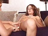 Three beautiful babes caress each other's pussy on the sofa