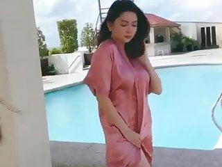 Sexy asian doing photoshoot...