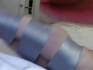 Busty JAV tied and gagged with tape on mattress
