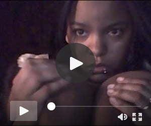 Ebony girl licks her huge boobs on webcam