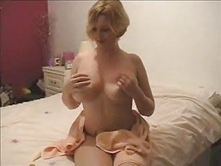 Busty Davina rubbing her huge melons