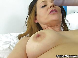 English milf Gemma Gold stuffs her shaven cunt with a dildo
