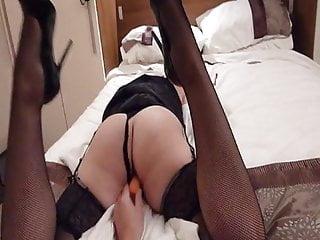 Sexy wife enjoying a carrot
