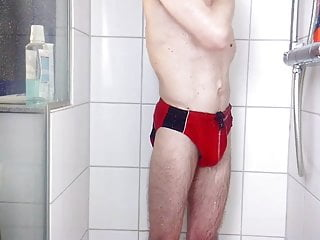 guy speedo red in in cockring shower with
