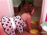 While wearing her cleaning outfit this hot brunette enjoys