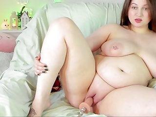 Huge slut caresses her hole with a sex machine