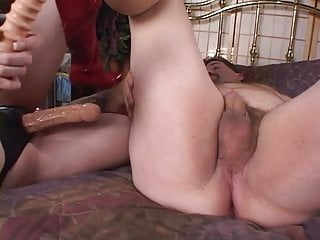 Guy getting strap on cock to ride