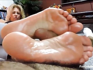 Blond milf give a long intimate footjob to...