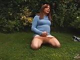 Tranny slut Luci May has a nice big garden wank and orgas
