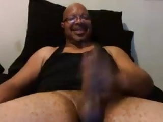 Older mature dad wanks his big black cock and creams hard