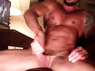 Muscele gay jerks while he looks porn...