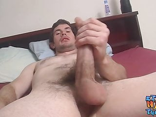 Handsome muscular jock tugs and wanks his large...