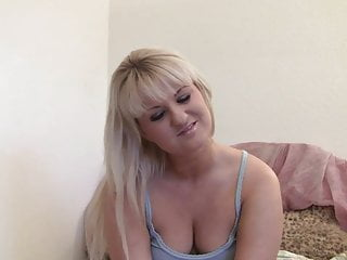 Flirty long hair blonde is chatting away on her laptop