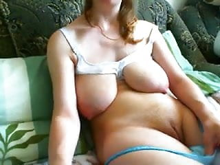 Sagging milky tits masturbates...